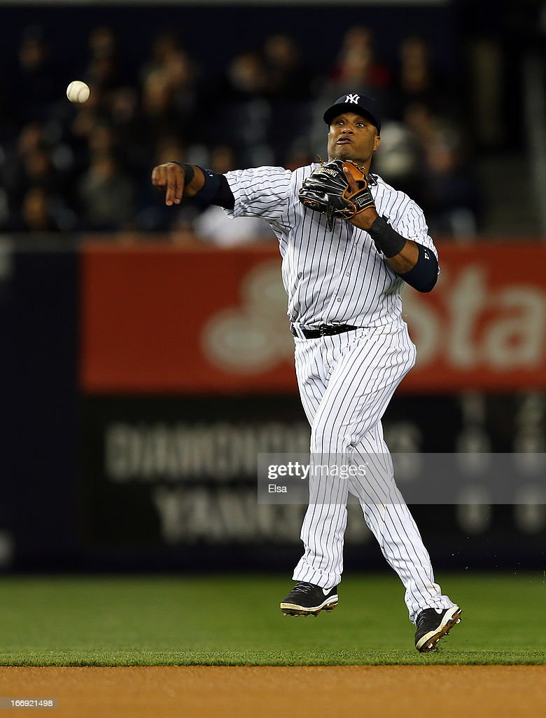 Robinson Cano #24 of the New York Yankees sends the ball to first for the out in the fourth inning against the Arizona Diamondbacks on April 18, 2013 at Yankee Stadium in the Bronx borough of New York City.