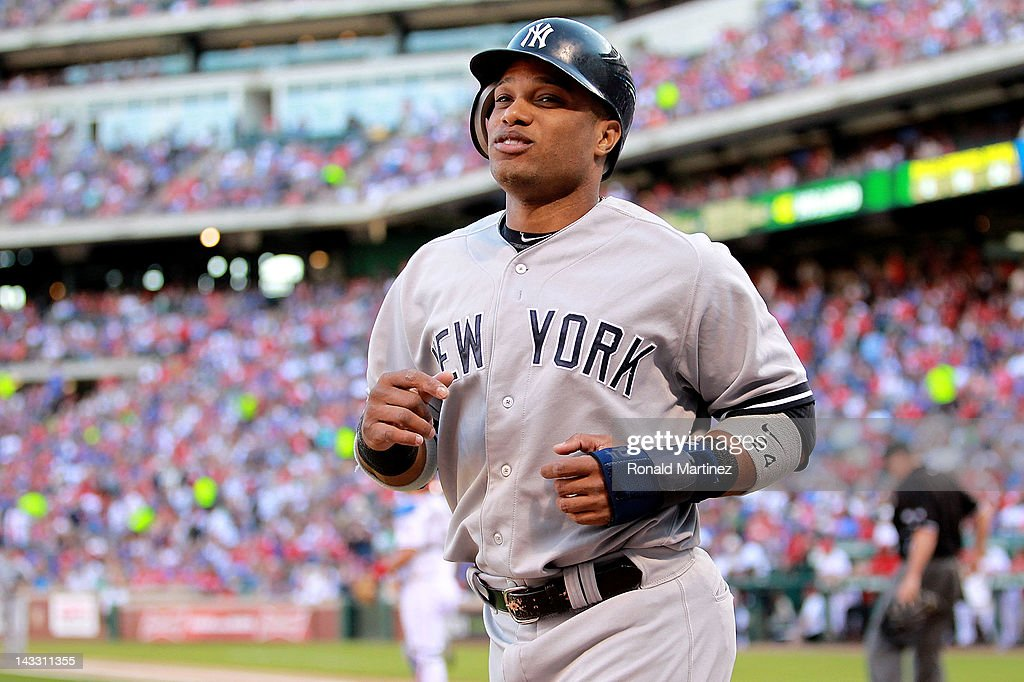 <a gi-track='captionPersonalityLinkClicked' href=/galleries/search?phrase=Robinson+Cano&family=editorial&specificpeople=538362 ng-click='$event.stopPropagation()'>Robinson Cano</a> #24 of the New York Yankees smiles after scoring against the Texas Rangers at Rangers Ballpark in Arlington on April 23, 2012 in Arlington, Texas.