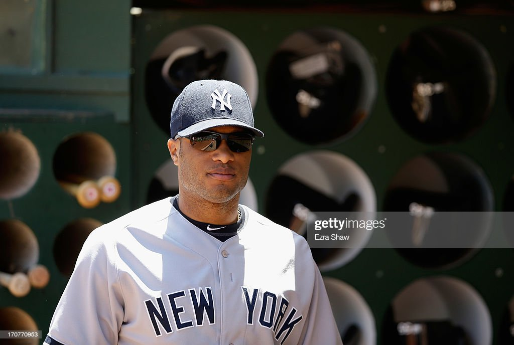 <a gi-track='captionPersonalityLinkClicked' href=/galleries/search?phrase=Robinson+Cano&family=editorial&specificpeople=538362 ng-click='$event.stopPropagation()'>Robinson Cano</a> #24 of the New York Yankees stands near the dugout before their game against the Oakland Athletics at O.co Coliseum on June 13, 2013 in Oakland, California.