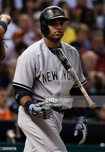 Robinson Cano of the New York Yankees strikes out in the sixth inning during the game against the Houston Astros at Minute Maid Park on September 27...