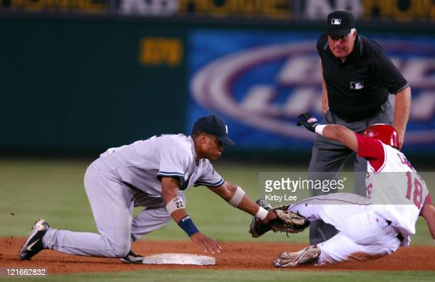 Robinson Cano of the New York Yankees tags out Orlando Cabrera of the Los Angeles Angels of Anaheim at second base in the fifth inning of a 86 loss...