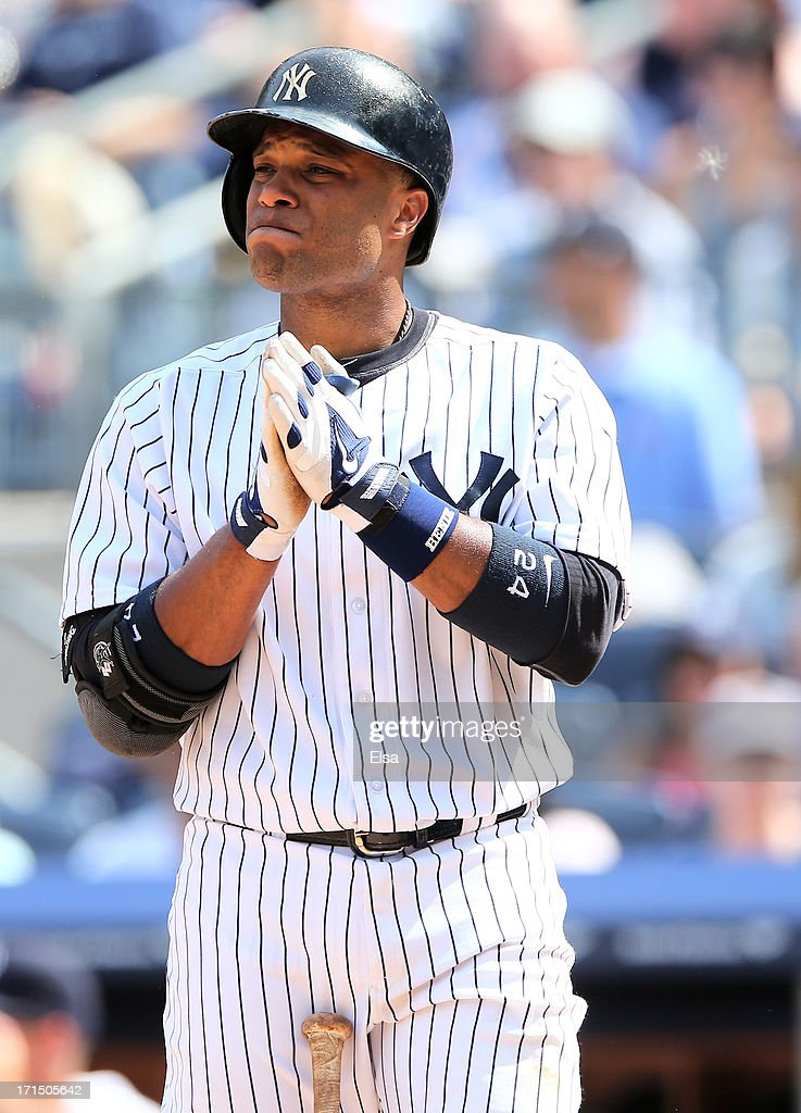 <a gi-track='captionPersonalityLinkClicked' href=/galleries/search?phrase=Robinson+Cano&family=editorial&specificpeople=538362 ng-click='$event.stopPropagation()'>Robinson Cano</a> #24 of the New York Yankees takes his turn at bat against the Tampa Bay Rays on June 22,2013 at Yankee Stadium in the Bronx borough of New York City.