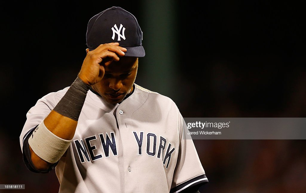 Robinson Cano #24 of the New York Yankees walks off the field following their loss against the Boston Red Sox during the game on September 11, 2012 at Fenway Park in Boston, Massachusetts.