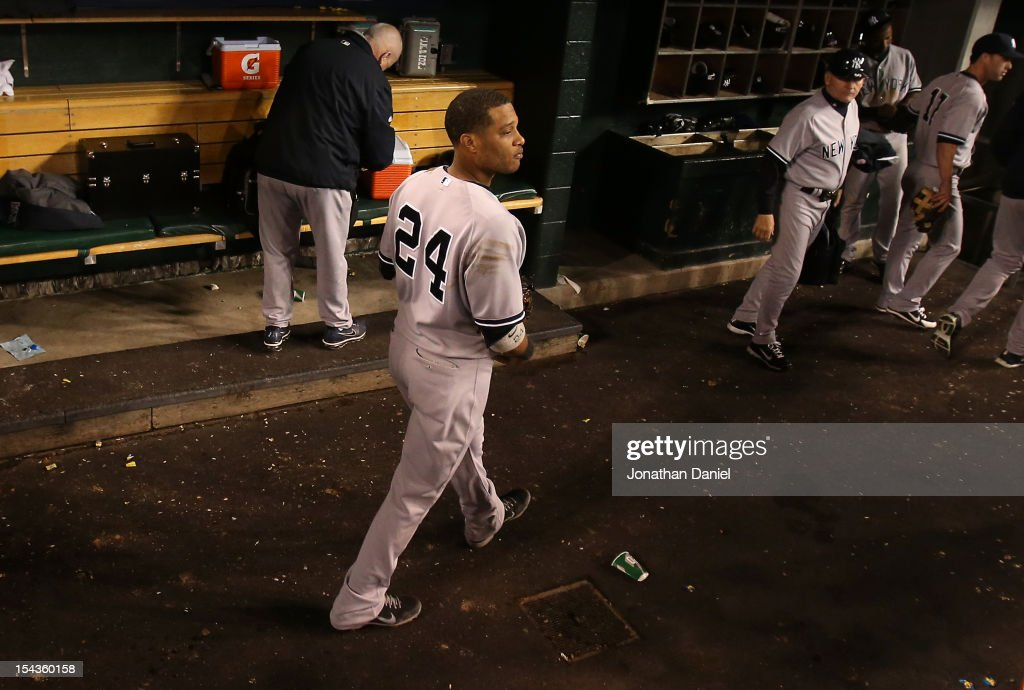 Robinson Cano #24 of the New York Yankees watches the Detroit Tigers celebrate on the field as Cano leaves the dugout after the Yankees lost 8-1 during game four of the American League Championship Series at Comerica Park on October 18, 2012 in Detroit, Michigan.