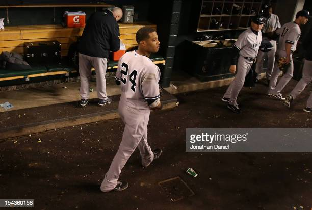 Robinson Cano of the New York Yankees watches the Detroit Tigers celebrate on the field as Cano leaves the dugout after the Yankees lost 81 during...