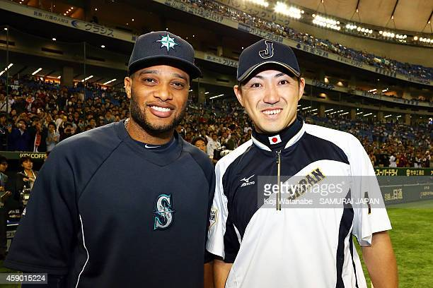 Robinson Cano of the Seattle Mariners and Seiichi Uchikawa of Samurai Japan pose for photographs during the game three of Samurai Japan and MLB All...
