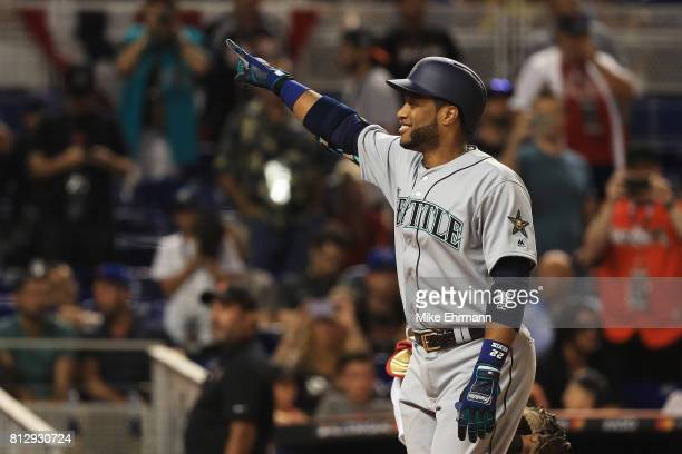 Robinson Cano of the Seattle Mariners and the American League celebrates hitting a home run in the tenth inning against the National League during...