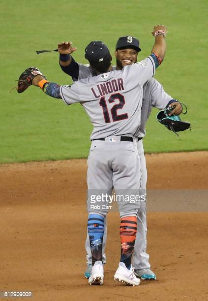 Robinson Cano of the Seattle Mariners and the American League and Francisco Lindor of the Cleveland Indians and the American League celebrate...