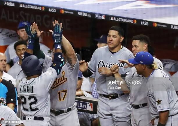 Robinson Cano of the Seattle Mariners and the American League celebrates with teammates after hitting a home run in the tenth inning against the...