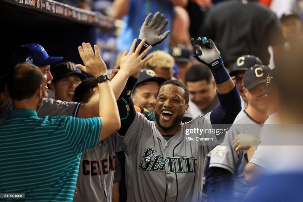 Robinson Cano #22 of the Seattle Mariners and the American League celebrates with teammates after hitting a home run in the tenth inning against the National League during the 88th MLB All-Star Game at Marlins Park on July 11, 2017 in Miami, Florida.
