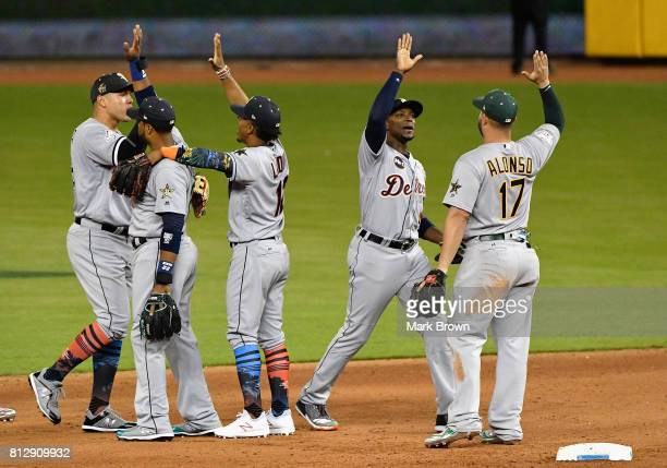 Robinson Cano of the Seattle Mariners and the American League celebrates with teammates after they defeated the National League 2 to 1 during the...