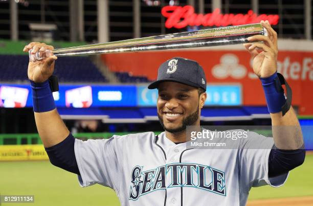 Robinson Cano of the Seattle Mariners and the American League celebrates with the Major League Baseball AllStar Game Most Valuable Player Award after...