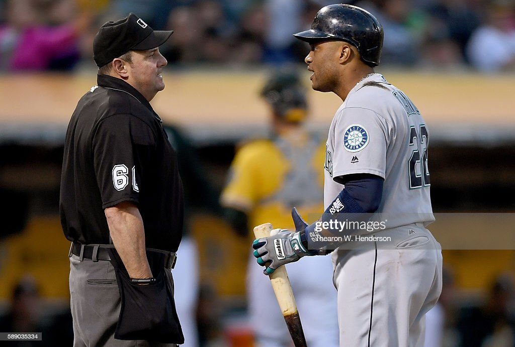 Robinson Cano #22 of the Seattle Mariners argues with home plate umpire Marty Foster that he fouled tipped a ball into the dirt that Foster called strike three on against the Oakland Athletics in the top of the fourth inning at the Oakland Coliseum on August 12, 2016 in Oakland, California.