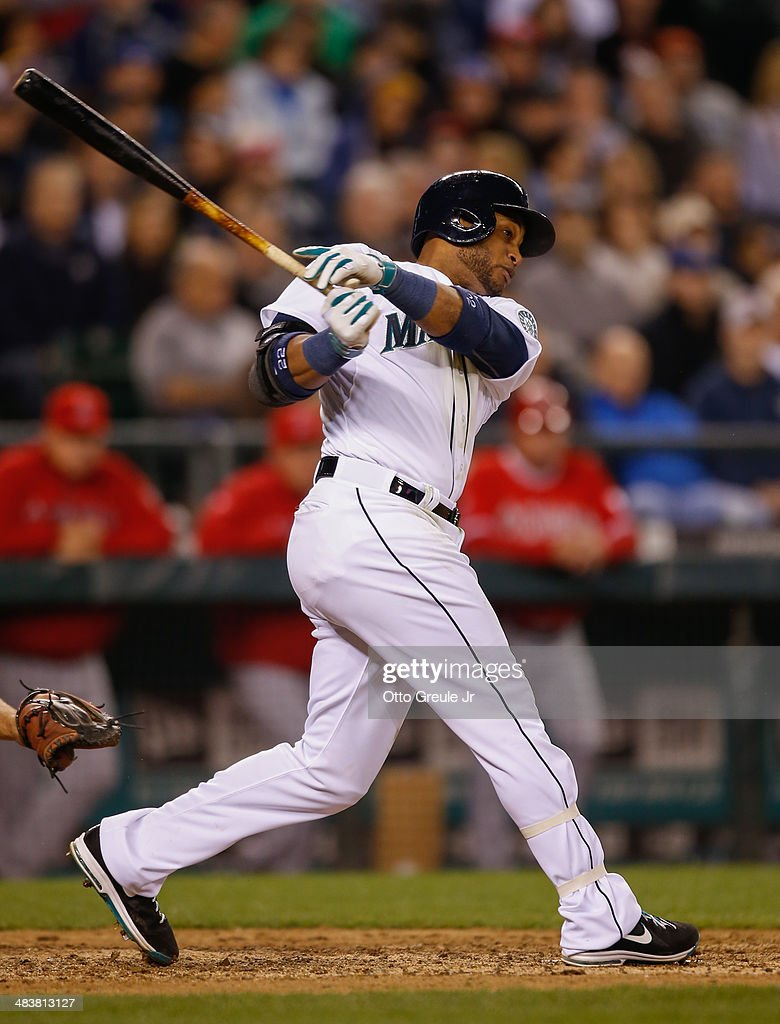 Robinson Cano #22 of the Seattle Mariners bats in the seventh inning against the Los Angeles Angels of Anaheim on Opening Day at Safeco Field on April 8, 2014 in Seattle, Washington.