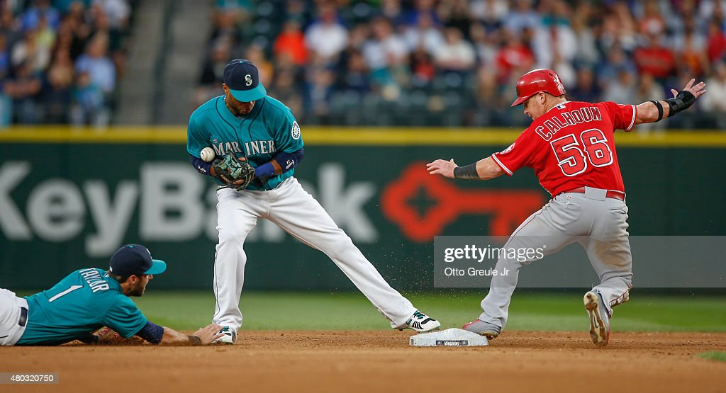<a gi-track='captionPersonalityLinkClicked' href=/galleries/search?phrase=Robinson+Cano&family=editorial&specificpeople=538362 ng-click='$event.stopPropagation()'>Robinson Cano</a> #22 of the Seattle Mariners bobbles the relay throw on a double play attempt from shortstop <a gi-track='captionPersonalityLinkClicked' href=/galleries/search?phrase=Chris+Taylor+-+Baseball+Player&family=editorial&specificpeople=13511734 ng-click='$event.stopPropagation()'>Chris Taylor</a> #1 (L) as <a gi-track='captionPersonalityLinkClicked' href=/galleries/search?phrase=Kole+Calhoun&family=editorial&specificpeople=9008672 ng-click='$event.stopPropagation()'>Kole Calhoun</a> #56 of the Los Angeles Angels of Anaheim reaches second at Safeco Field on July 10, 2015 in Seattle, Washington. Taylor was charged with an error on the play.