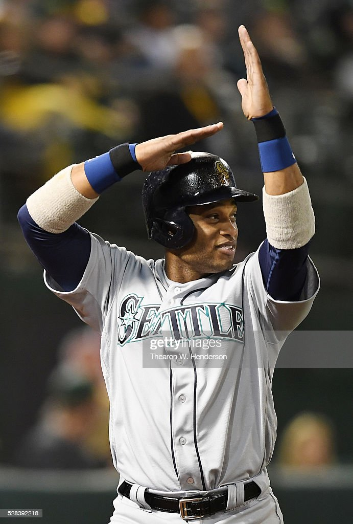 <a gi-track='captionPersonalityLinkClicked' href=/galleries/search?phrase=Robinson+Cano&family=editorial&specificpeople=538362 ng-click='$event.stopPropagation()'>Robinson Cano</a> #22 of the Seattle Mariners celebrates after he scored against the Oakland Athletics in the top of the six inning at O.co Coliseum on May 2, 2016 in Oakland, California.