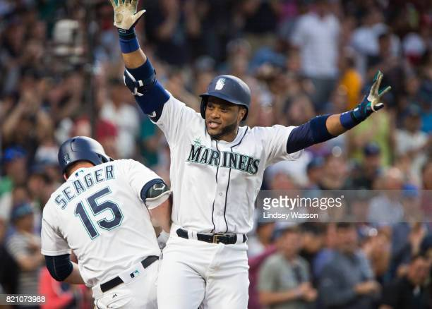 Robinson Cano of the Seattle Mariners celebrates his home run with Kyle Seager to put the Mariners ahead in the eighth inning against the New York...