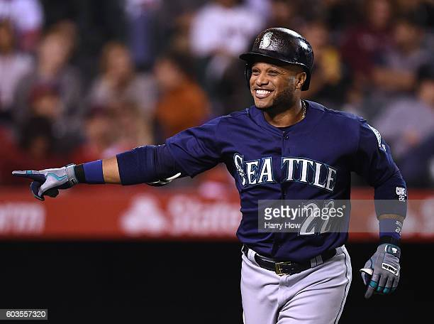 Robinson Cano of the Seattle Mariners celebrates his solo homerun to take a 20 lead over the Los Angeles Angels of Anaheim during the third inning at...