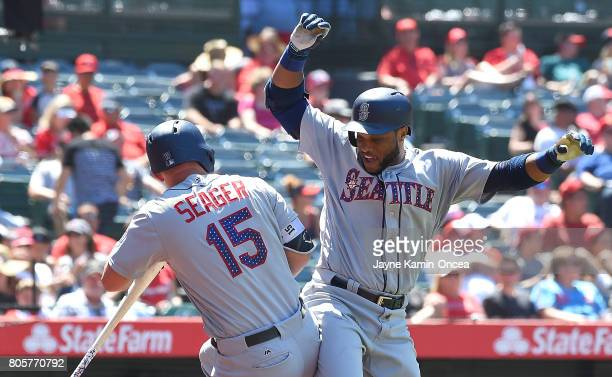 Robinson Cano of the Seattle Mariners celebrates with Kyle Seager of the Seattle Mariners after hitting a three run home run in the eighth inning of...