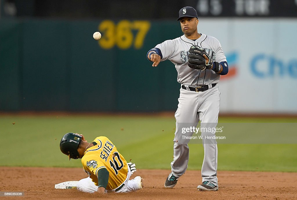 Robinson Cano #22 of the Seattle Mariners completes the double-play getting his throw off over the top of Marcus Semien #10 of the Oakland Athletics in the bottom of the third inning at the Oakland Coliseum on August 12, 2016 in Oakland, California.