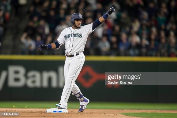 Robinson Cano of the Seattle Mariners gestures after hitting a double off of Charlie Morton of the Houston Astros during the first inning of the home...