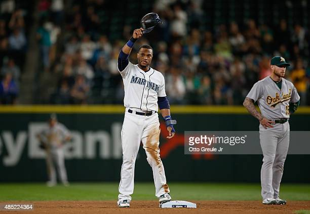 Robinson Cano of the Seattle Mariners gestures to the crowd after doubling against the Oakland Athletics in the seventh inning at Safeco Field on...