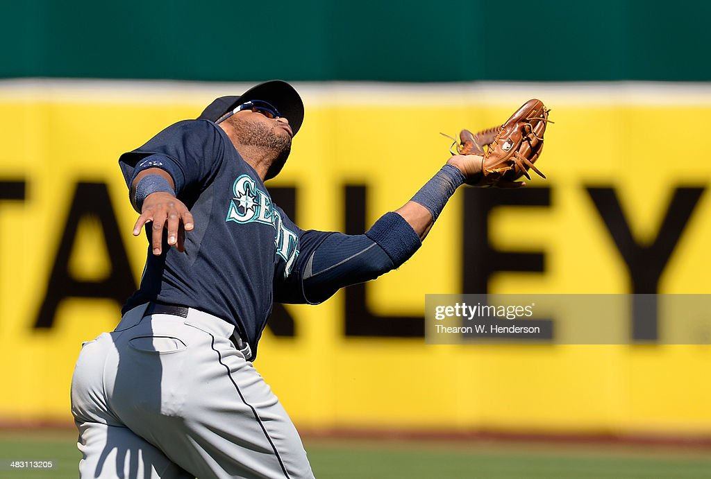 <a gi-track='captionPersonalityLinkClicked' href=/galleries/search?phrase=Robinson+Cano&family=editorial&specificpeople=538362 ng-click='$event.stopPropagation()'>Robinson Cano</a> #22 of the Seattle Mariners goes back to catch a short fly ball off the bat of Brandon Moss #37 of the Oakland Athletics (not pictured) in the bottom of the fifth inning at O.co Coliseum on April 6, 2014 in Oakland, California. The Athletics won the game 6-3.