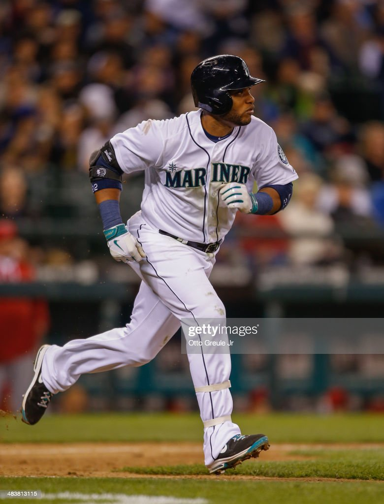 Robinson Cano #22 of the Seattle Mariners heads to first on a groundout in the seventh inning against the Los Angeles Angels of Anaheim on Opening Day at Safeco Field on April 8, 2014 in Seattle, Washington.