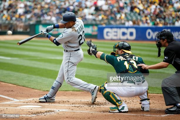 Robinson Cano of the Seattle Mariners hits a home run against the Oakland Athletics during the first inning at the Oakland Coliseum on April 22 2017...