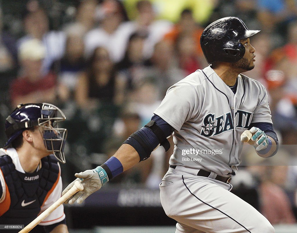 <a gi-track='captionPersonalityLinkClicked' href=/galleries/search?phrase=Robinson+Cano&family=editorial&specificpeople=538362 ng-click='$event.stopPropagation()'>Robinson Cano</a> #22 of the Seattle Mariners hits a three run home run in the seventh inning against the Houston Astros at Minute Maid Park on June 30, 2014 in Houston, Texas.