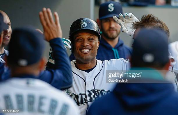 Robinson Cano of the Seattle Mariners is congratulated by teammates after hitting a solo home run against the Chicago White Sox in the fourth inning...