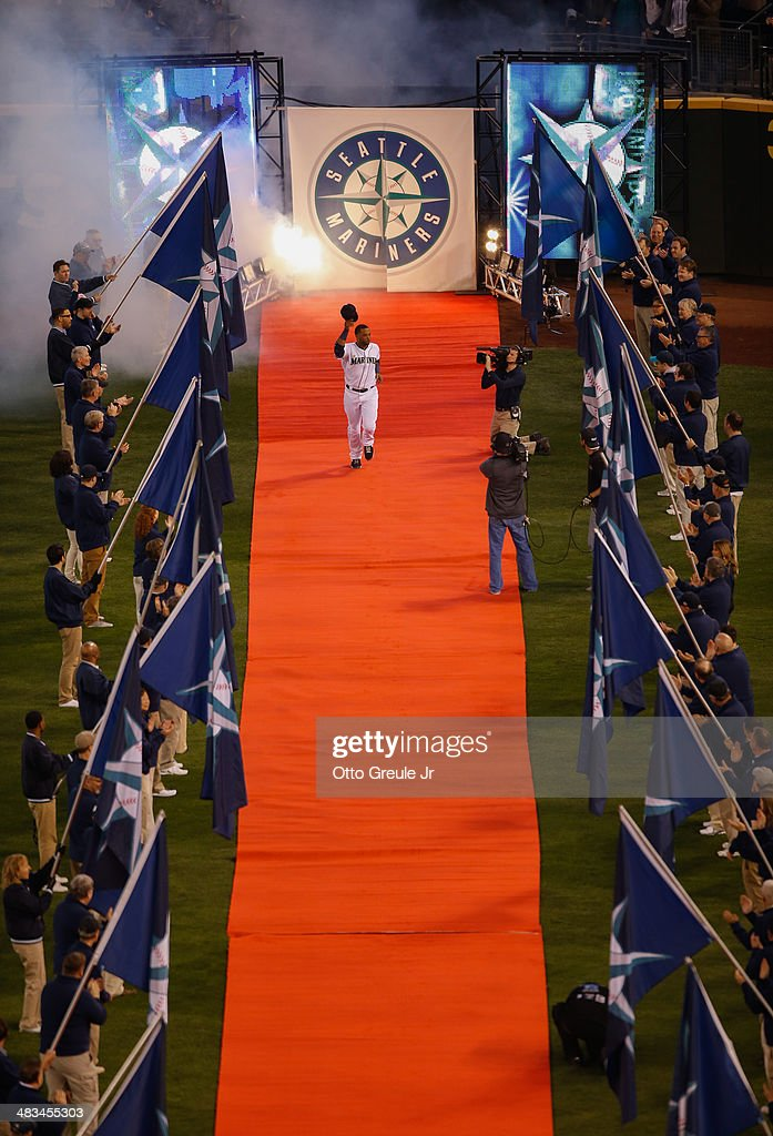 <a gi-track='captionPersonalityLinkClicked' href=/galleries/search?phrase=Robinson+Cano&family=editorial&specificpeople=538362 ng-click='$event.stopPropagation()'>Robinson Cano</a> #22 of the Seattle Mariners is introduced prior to the game against the Los Angeles Angels of Anaheim on Opening Day at Safeco Field on April 8, 2014 in Seattle, Washington.