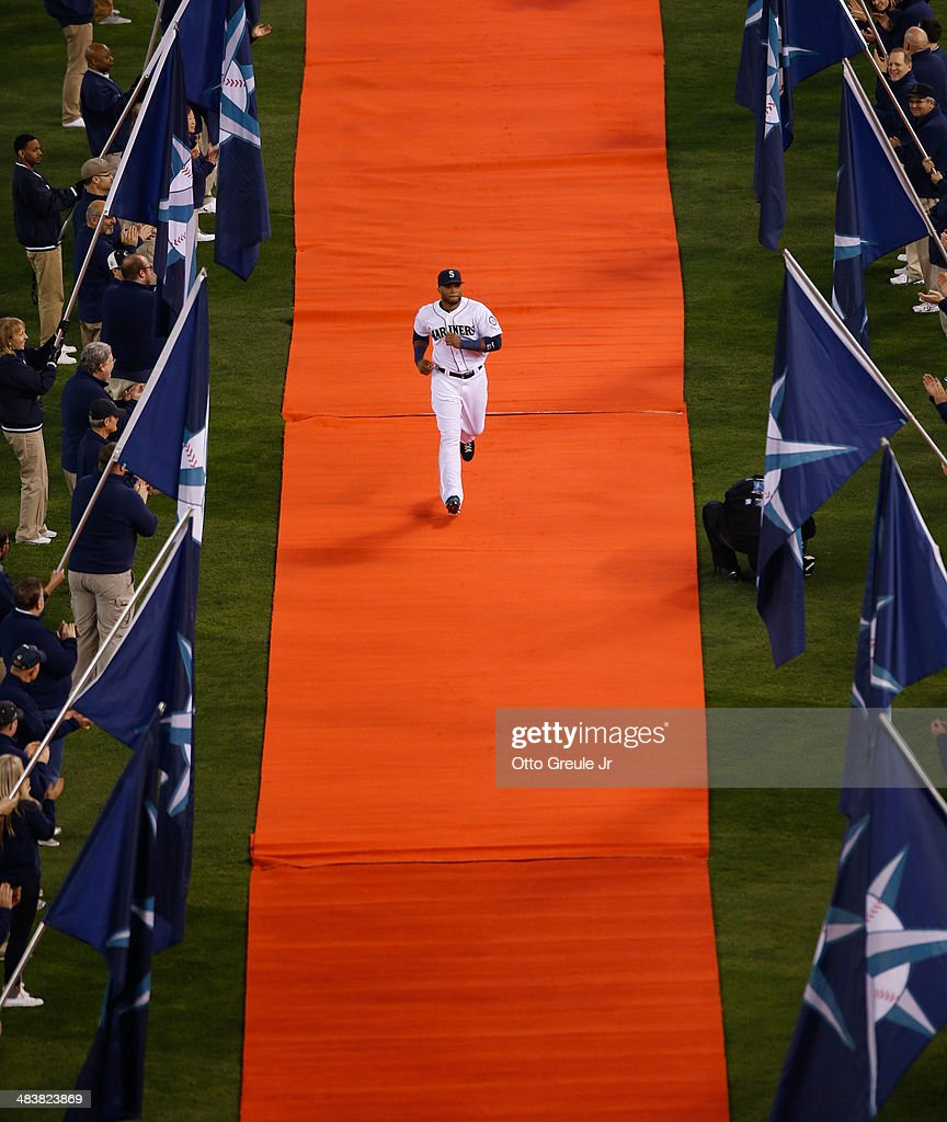 Robinson Cano #22 of the Seattle Mariners is introduced prior to the game against the Los Angeles Angels of Anaheim on Opening Day at Safeco Field on April 8, 2014 in Seattle, Washington.