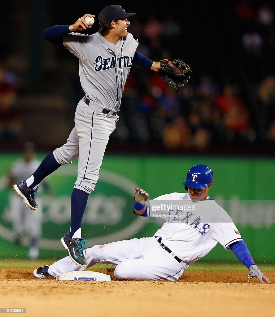 <a gi-track='captionPersonalityLinkClicked' href=/galleries/search?phrase=Robinson+Cano&family=editorial&specificpeople=538362 ng-click='$event.stopPropagation()'>Robinson Cano</a> #22 of the Seattle Mariners makes the throw to first base after tagging out Leonys Martin #2 of the Texas Rangers in the bottom of the seventh inning at Globe Life Park in Arlington on September 5, 2014 in Arlington, Texas.