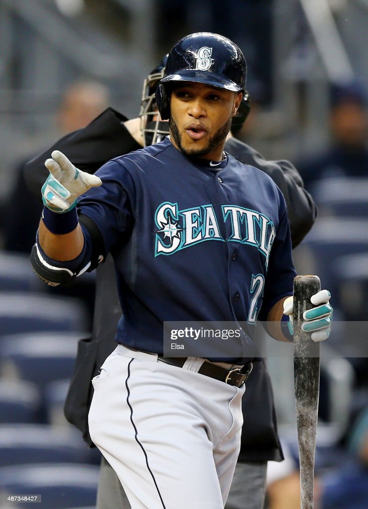 <a gi-track='captionPersonalityLinkClicked' href=/galleries/search?phrase=Robinson+Cano&family=editorial&specificpeople=538362 ng-click='$event.stopPropagation()'>Robinson Cano</a> #22 of the Seattle Mariners points to the New York Yankees bench in the first inning on April 29, 2014 at Yankee Stadium in the Bronx borough of New York City.