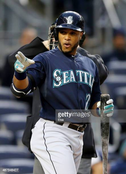 Robinson Cano of the Seattle Mariners points to the New York Yankees bench in the first inning on April 29 2014 at Yankee Stadium in the Bronx...