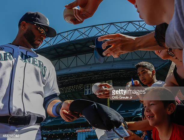 Robinson Cano of the Seattle Mariners signs autographs for fans prior to the game against the Baltimore Orioles at Safeco Field on July 27 2014 in...