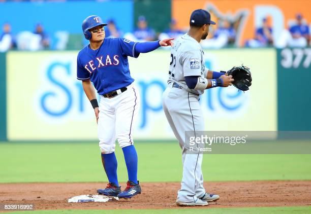 Robinson Cano of the Seattle Mariners tags out ShinSoo Choo of the Texas Rangers on second base in the first inning at Globe Life Park in Arlington...