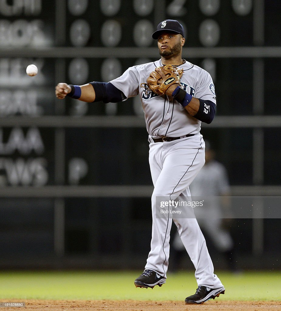 <a gi-track='captionPersonalityLinkClicked' href=/galleries/search?phrase=Robinson+Cano&family=editorial&specificpeople=538362 ng-click='$event.stopPropagation()'>Robinson Cano</a> #22 of the Seattle Mariners throws to first base against the Houston Astros at Minute Maid Park on June 30, 2014 in Houston, Texas.