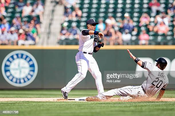 Robinson Cano of the Seattle Mariners turns a double play as Jordan Danks of the Chicago White Sox slides into second base during the game at Safeco...