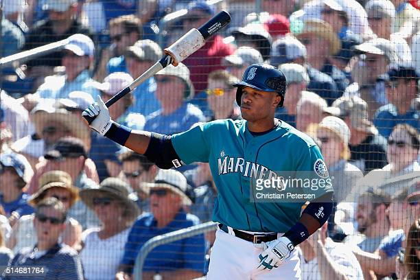 Robinson Cano of the Seattle Mariners warms up on deck during the second inning of the spring training game against the Chicago Cubs at Peoria...