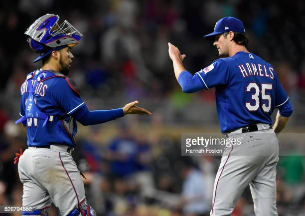 Robinson Chirinos and Cole Hamels of the Texas Rangers celebrate winning against the Minnesota Twins after the game on August 5 2017 at Target Field...