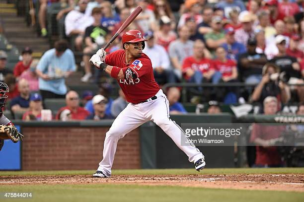 Robinson Chirinos of the Texas Rangers bats against the Boston Red Sox at Globe Life Park in Arlington on May 30 2015 in Arlington Texas The Texas...