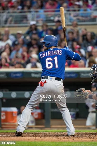 Robinson Chirinos of the Texas Rangers bats against the Minnesota Twins on August 5 2017 at Target Field in Minneapolis Minnesota The Rangers...