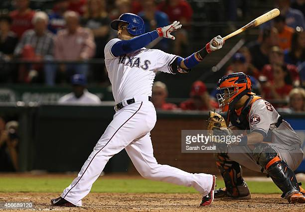 Robinson Chirinos of the Texas Rangers bats during a game against the Houston Astros at Globe Life Park in Arlington on September 23 2014 in...