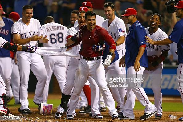 Robinson Chirinos of the Texas Rangers celebrates after hitting a walkoff home run in the ninth inning during a game against the Los Angeles Dodgers...