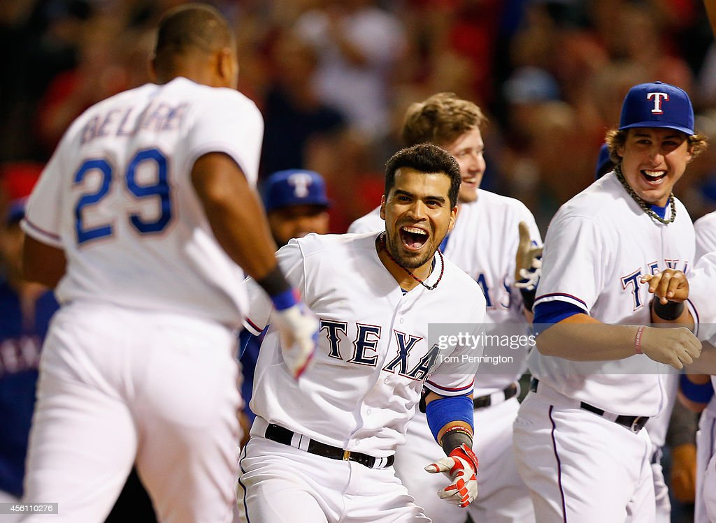 <a gi-track='captionPersonalityLinkClicked' href=/galleries/search?phrase=Robinson+Chirinos&family=editorial&specificpeople=6809195 ng-click='$event.stopPropagation()'>Robinson Chirinos</a> #61 of the Texas Rangers celebrates with <a gi-track='captionPersonalityLinkClicked' href=/galleries/search?phrase=Adrian+Beltre&family=editorial&specificpeople=202631 ng-click='$event.stopPropagation()'>Adrian Beltre</a> #29 of the Texas Rangers at home plate after Beltre hit the game winning walk-off homerun against the Oakland Athletics in the bottom of the ninth inning at Globe Life Park in Arlington on September 25, 2014 in Arlington, Texas.
