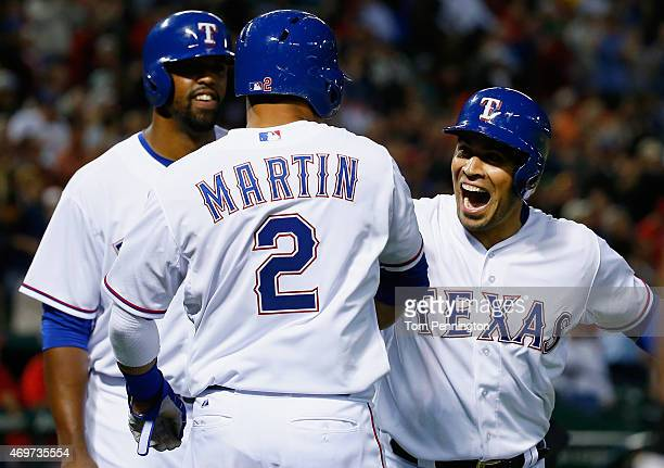 Robinson Chirinos of the Texas Rangers celebrates with Carlos Peguero of the Texas Rangers and Leonys Martin of the Texas Rangers after hitting a...