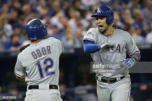 Robinson Chirinos of the Texas Rangers celebrates with his teammate Rougned Odor after hitting a two run home run to left center field against David...