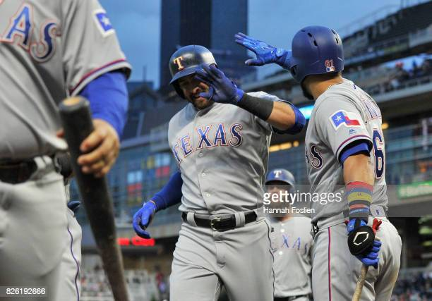 Robinson Chirinos of the Texas Rangers congratulates teammate Joey Gallo on a threerun home run against the Minnesota Twins during the fourth inning...